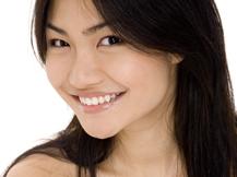 Patient using metal free dentistry in Calgary